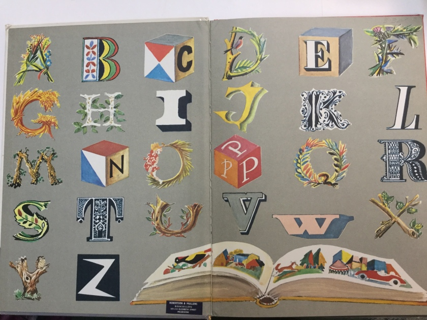 Open pages of a children's book showing letters of the alphabet represented in many different styles