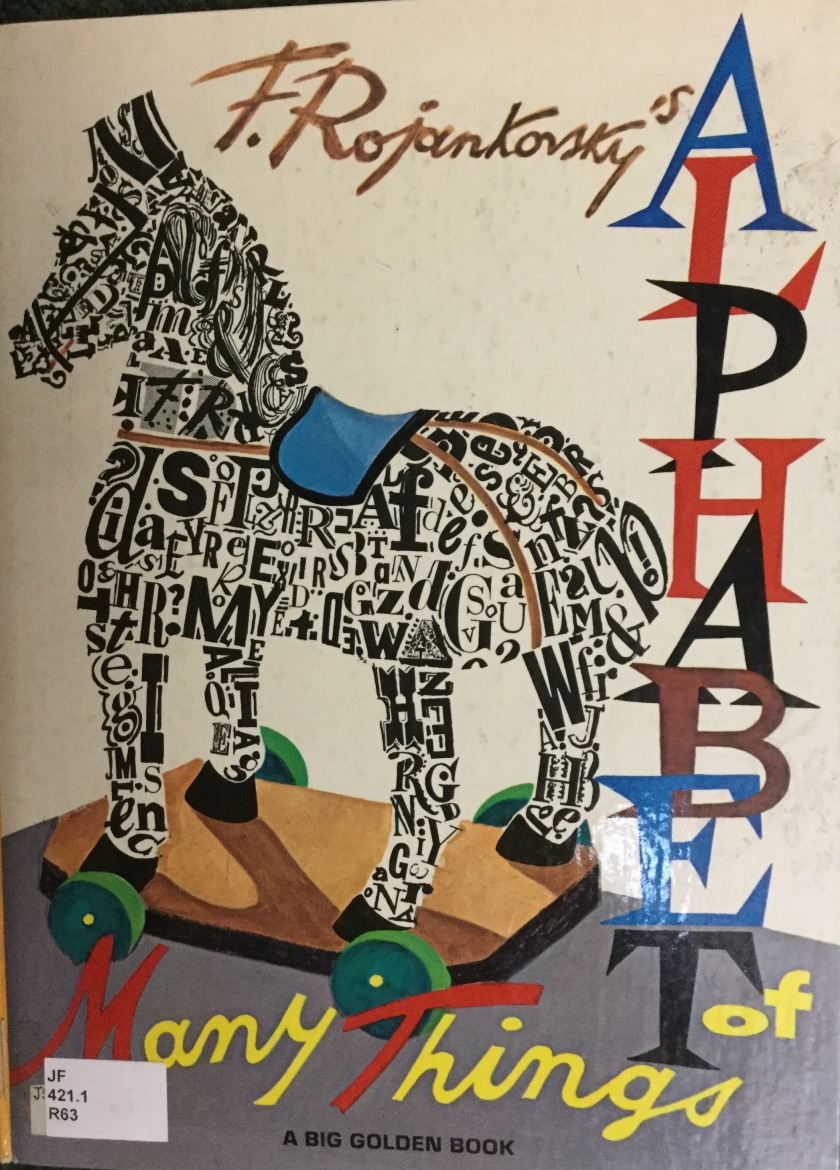 Cover of a children's alphabet book showing a toy horse made of letters